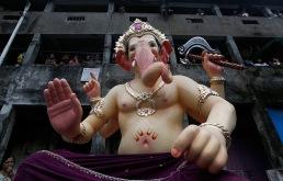 Mumbai, India: People look at an idol of Hindu elephant-headed god Ganesh